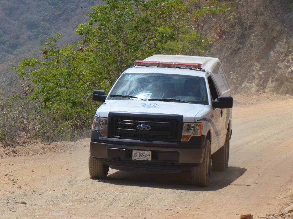 Hallan cadáver en compuerta de  canal de riego en Pino Suárez