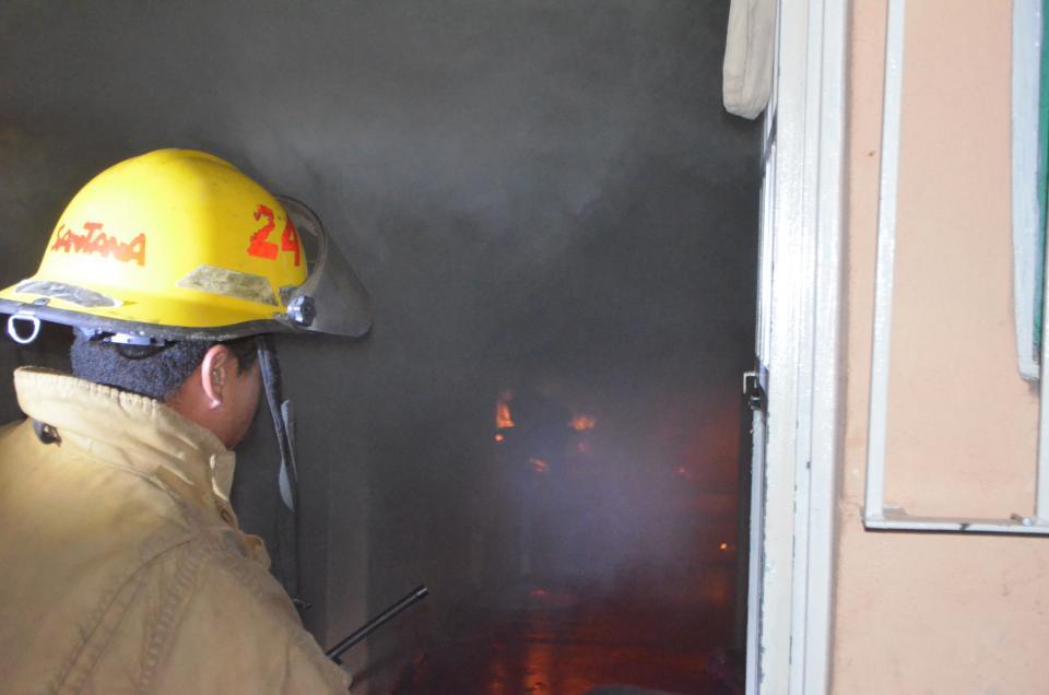 Incendio en habitación  de un domicilio