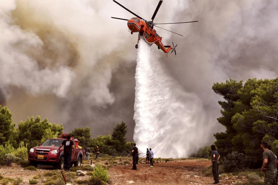 Grecia en duelo por virulentos  incendios; más de 70 muertos