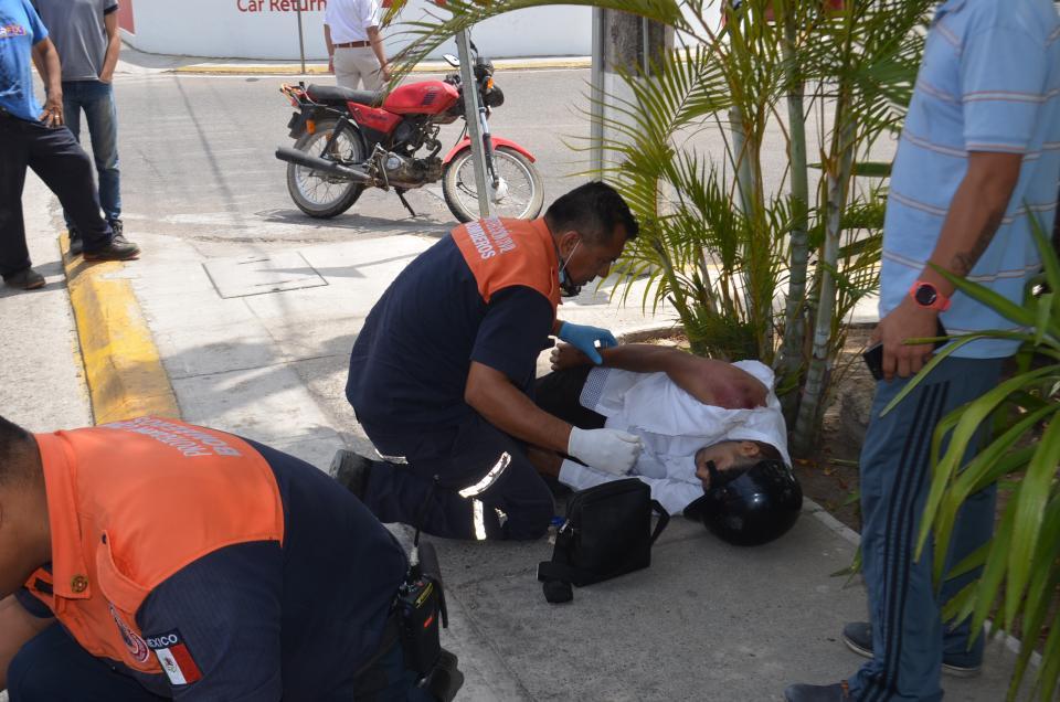 Mujer atropelladapor motociclista