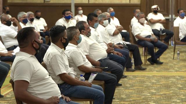 Taxistas en una reunión