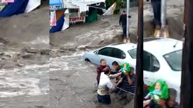 Bebé rescatado tras las inundaciones en Ecatepc